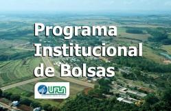 Foto aérea do campus da UFLA com os dizeres: programa institucional de bolsas