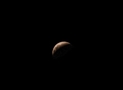 Foto feita por Marcus Ribeiro, na UFLA, durante o eclipse.