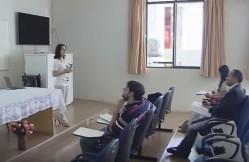 Aloísia Hirata apresenta a pesquisa sobre o sistema participativo e da agroecologia com produtores familiares da região